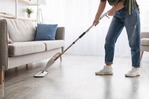 Obraz na płótnie Portrait of muslim woman cleaning floor with spray mop