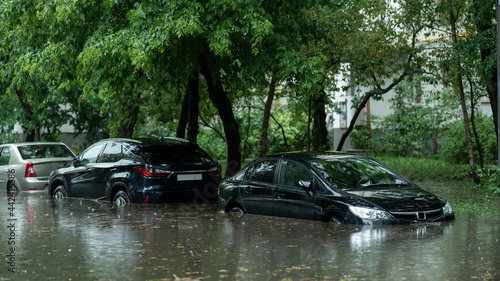 Fotografie, Obraz Flooded cars on the street of the city