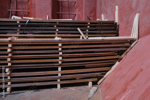 Photo View of wooden separation and dunnage of hot rolled steel plates inside cargo ho
