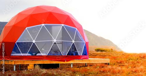 Red geo-dome tent on Kamchatka peninsula Fotobehang