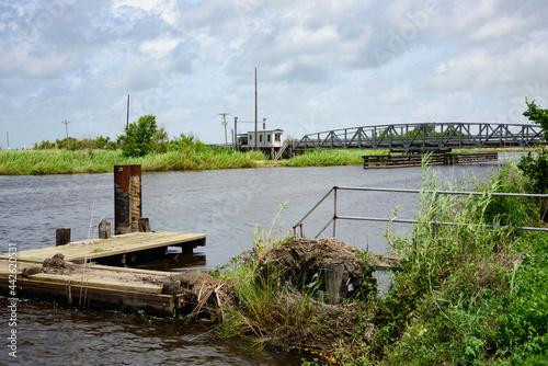 Wallpaper Mural Historic pony truss swing bridge over the Mermentau River, Cameron Parish, Louisiana, with hurricane Laura aftermath