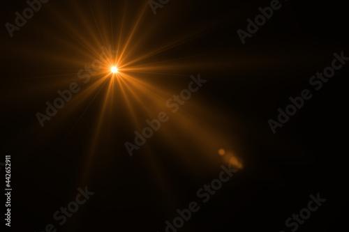 Fotografie, Tablou Lens flare effect on black background