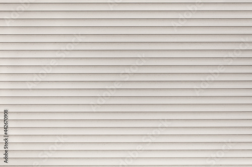 Wallpaper Mural White siding wall as an abstract background.