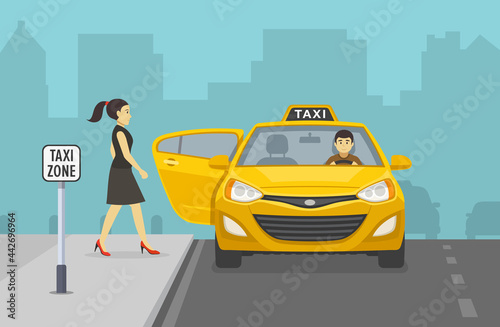 Fotografia Young woman getting into yellow taxi cab