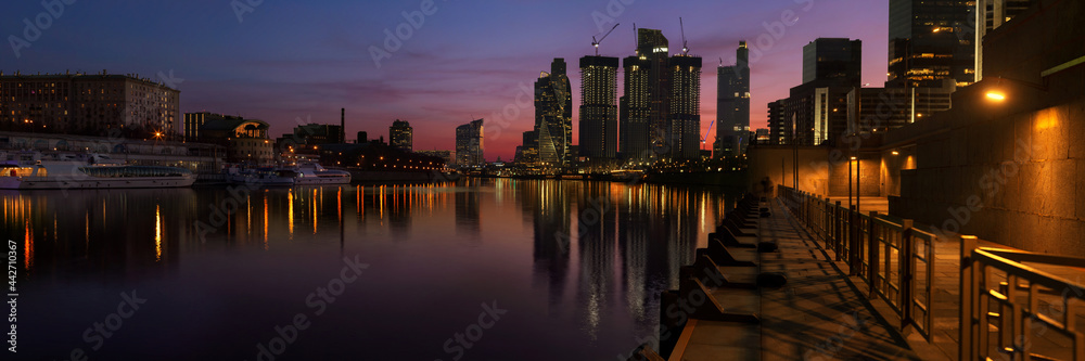 Panorama of Moscow city skyscrapers and Moskva river at sunset