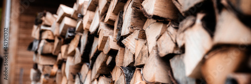 Obraz na płótnie a woodpile with harvesting and stacked firewood of chopped wood for kindling and heating the house