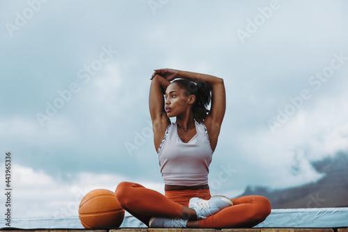 Fotografie, Obraz Healthy woman taking break from workout on rooftop