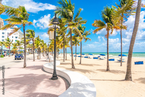 Fotografie, Obraz Seafront beach promenade with palm trees on a sunny day in Fort Lauderdale