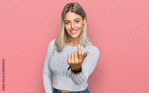 Murais de parede Beautiful blonde woman wearing casual clothes beckoning come here gesture with h