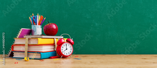 Tableau sur Toile Ready for school concept background with books, alarm clock and accessory 3D Ren