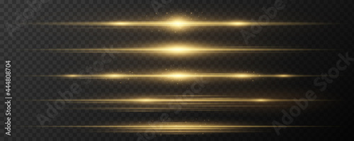 Set of horizontal golden light effects on a dark transparent background. Collection of luxurious beams. Bright rays with glowing dust. Optical glare. Vector