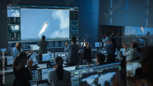 Billede på lærred Group of People in Mission Control Center Witness Successful Space Rocket Launch