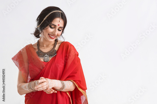 Beautiful Indian woman on white background Fototapete