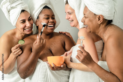 Stampa su Tela Happy multiracial women with different age and body size having skin care spa da