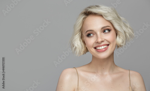 Canvas Portrait of a beautiful smiling blonde girl with a short haircut