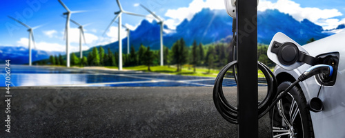Fotografie, Obraz EV charging station for electric car in concept of green sustainable energy produced from renewable resources to supply to charger station in order to reduce CO2 emission