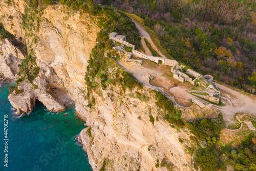 Canvastavla Drone with camera rises above ruins of Mogren fortress in Budva, Montenegro, sur