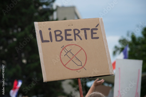 Fototapeta Portrait of people protesting in the street against the sanitary pass with bann