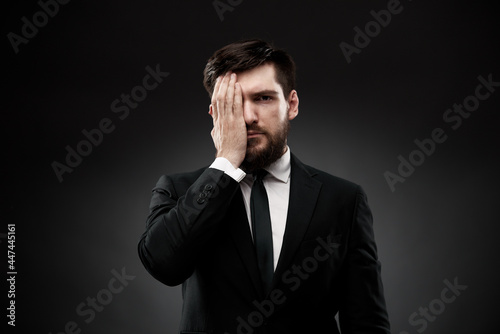 Fotografia, Obraz Man covering face with one hand showing emotional stress