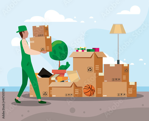 Fototapeta Delivery man with moving out boxes