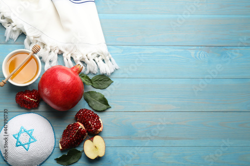 Fotografie, Obraz Flat lay composition with Rosh Hashanah holiday attributes on light blue wooden table