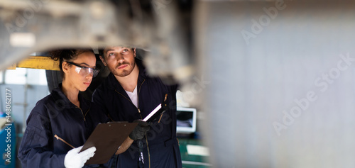 Canvastavla Hispanic Female trainee Mechanics Working Underneath Car Together Car maintenance and auto service garage