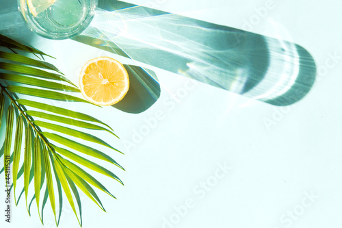 Cool summer drinks - lemonade or soda in glass on blue color background with pal Fototapet