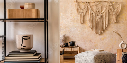 Tableau sur Toile Interior design of stylish living room with chaise longue, beautiful macrame, rattan decoration, plants, book, plant, elegant personal accessories in oriental concept of home decor