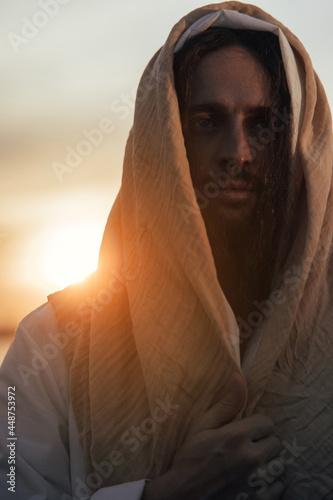 Leinwand Poster Portrait of Jesus Christ in white robe at sunset.