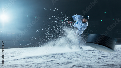 Canvas Print Ice Hockey Rink Arena: Professional Player Shooting the Puck with Hockey Stick