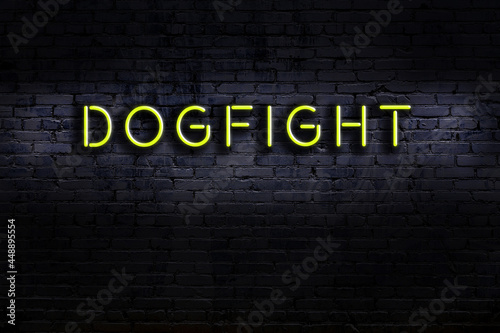Foto Night view of neon sign on brick wall with inscription dogfight