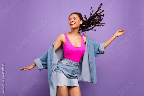 Fototapeta Portrait of attractive carefree slim trendy girl dancing having fun resting isol