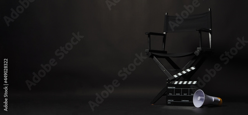 Fotografiet Black director chair and Clapper board or movie Clapperboard with megaphone on black background