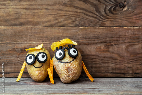 funny potato head with face on wooden background фототапет