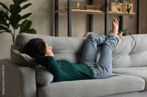 Fotografija Close up peaceful barefoot young woman resting on couch at home, positive attrac