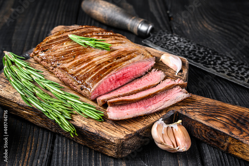 BBQ Grilled flank or flap beef meat steak on a wooden cutting board Fototapete