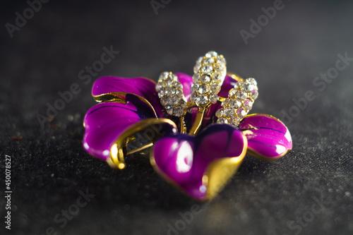 Closeup shot of a beautiful brooch in the shape of a flower Fototapet