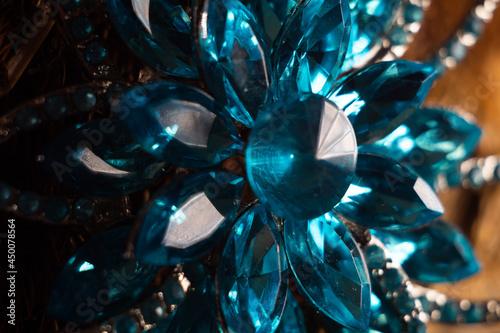 Closeup shot of a beautiful blue brooch in the shape of a flower Fototapete