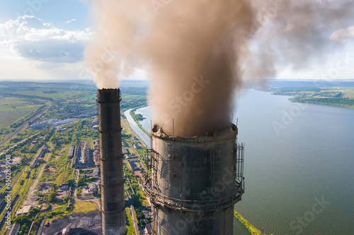 Aerial view of coal power plant high pipes with black smokestack polluting atmosphere Fototapete