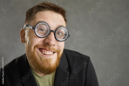 Funny curious man wearing retro vintage thick rimmed glasses smiling at camera фототапет