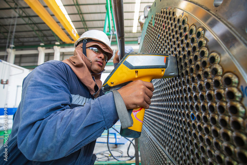 Canvas Print Male worker inspection weld of heat exchanger tube