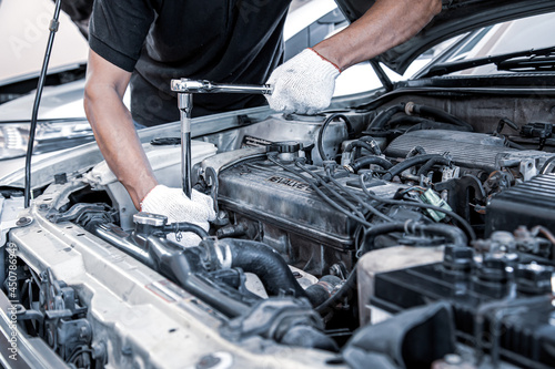 Car care maintenance and servicing, Close-up hand technician auto mechanic using the wrench to repairing change spare part car engine problem Fototapet