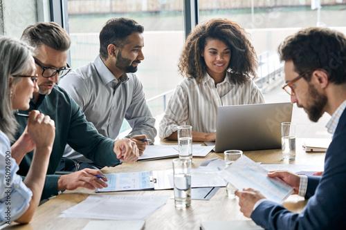 Fotografía Diverse executive businesspeople discuss corporation financial plan at boardroom meeting table