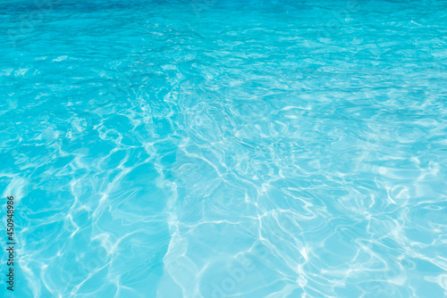 Stampa su Tela Blue water surface in swimming pool with sun reflection,  Ripple wave in pool fo