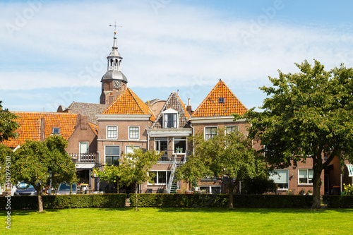 Old houses and church tower in the picturesque town of Blokzijl, Netherlands Fotobehang