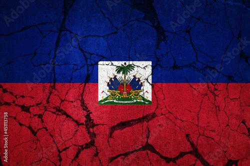 Obraz na plátne A cracked flag of Haiti. Devastation caused by major earthquake.