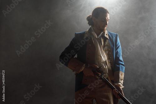 Fotografie, Obraz Man in uniform of an officer of Patriots of Revolutionary War with musket