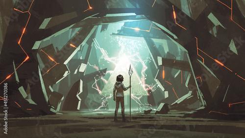 Fotografia child with spear standing in a cave full of many futuristic stone blocks, digita