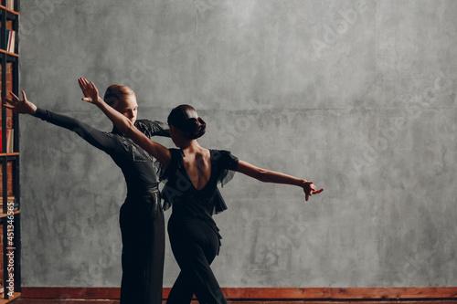 Young couple dancers dancing ballroom dance Paso doble. Fototapet