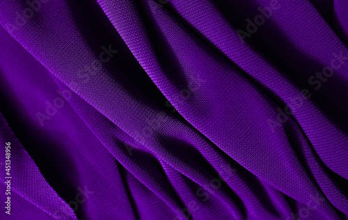 Smooth elegant violet satin texture can use as abstract background. Luxurious background design. Closeup purple texture
